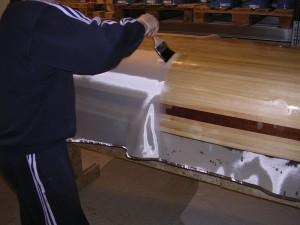Legging av glassfiberduk og epoksy